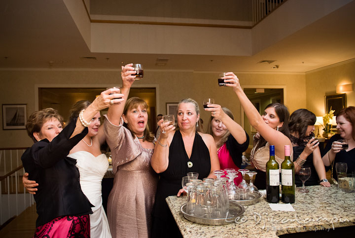 Guests having drink and toast to the newly wed couple. Mariott Aspen Wye River Conference Center Wedding photos at Queenstown Eastern Shore Maryland, by photographers of Leo Dj Photography.