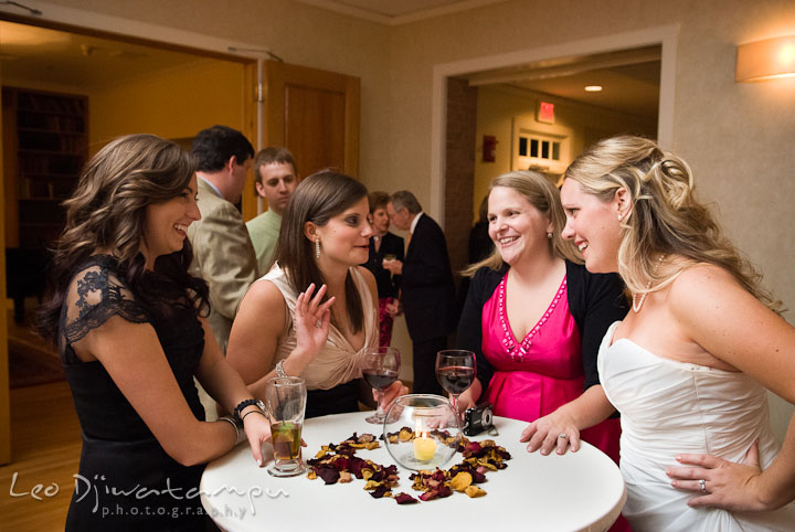 Guests talking and laughing with Bride. Mariott Aspen Wye River Conference Center Wedding photos at Queenstown Eastern Shore Maryland, by photographers of Leo Dj Photography.