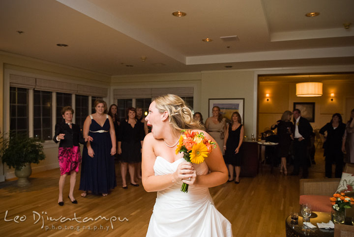 Bride ready for bouquet toss. Mariott Aspen Wye River Conference Center Wedding photos at Queenstown Eastern Shore Maryland, by photographers of Leo Dj Photography.