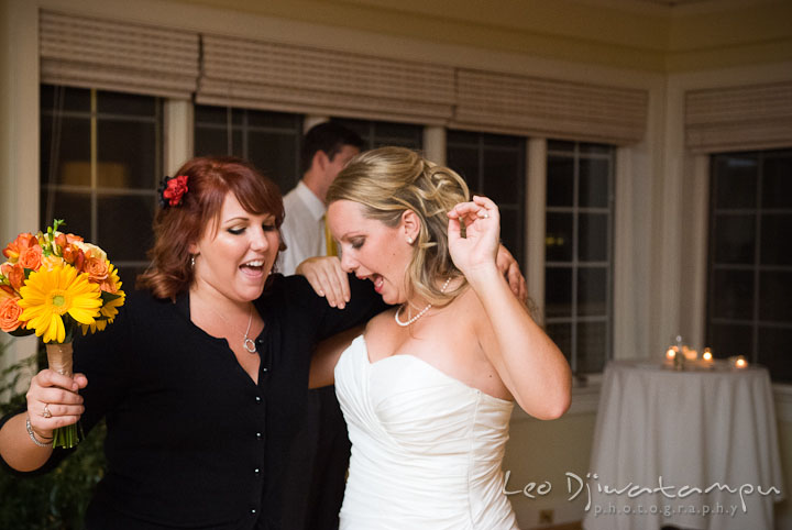 "Bride dancing to Britney Spears ""Baby One More Time"" with best friend. Mariott Aspen Wye River Conference Center Wedding photos at Queenstown Eastern Shore Maryland, by photographers of Leo Dj Photography."