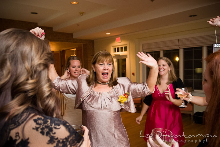 Mother of Bride dancing with guests. Mariott Aspen Wye River Conference Center Wedding photos at Queenstown Eastern Shore Maryland, by photographers of Leo Dj Photography.