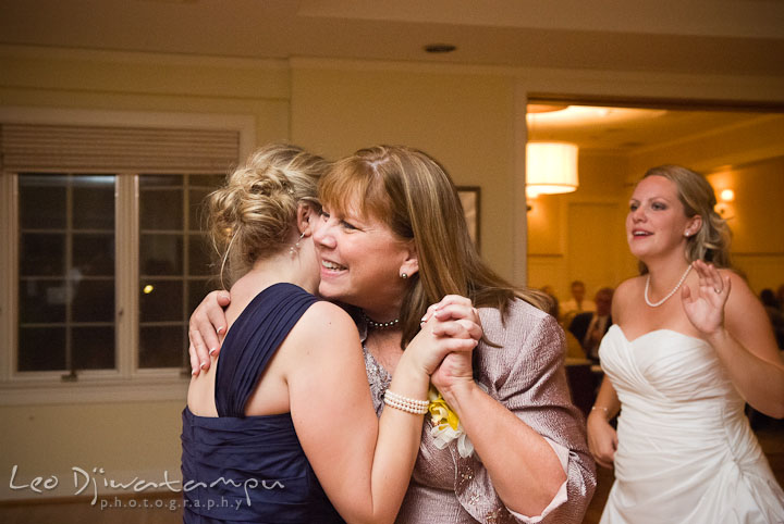 Mother of Bride and Bride's sister, Maid of Honor, hugging. Mariott Aspen Wye River Conference Center Wedding photos at Queenstown Eastern Shore Maryland, by photographers of Leo Dj Photography.