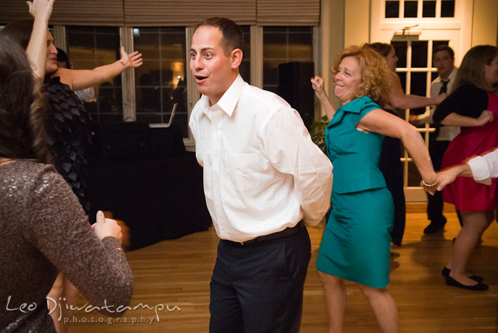 Groom dancing with other guests. Mariott Aspen Wye River Conference Center Wedding photos at Queenstown Eastern Shore Maryland, by photographers of Leo Dj Photography.