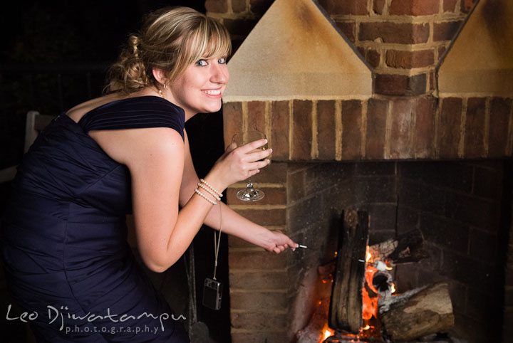 Maid of honor roasting marshmallow for s'mores. Mariott Aspen Wye River Conference Center Wedding photos at Queenstown Eastern Shore Maryland, by photographers of Leo Dj Photography.