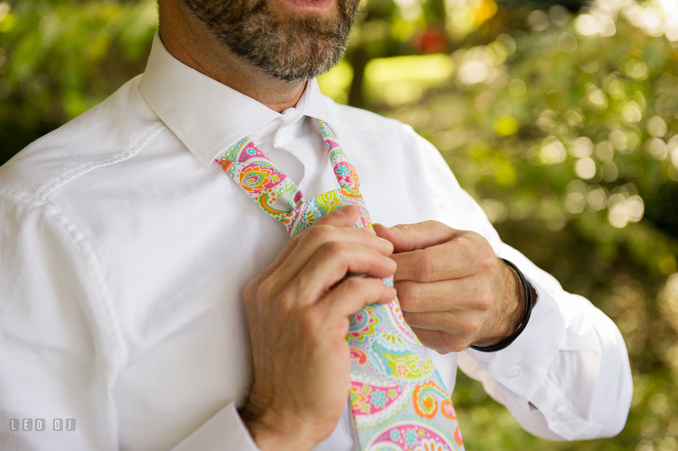 At home backyard wedding Groom put on tie photo by Leo Dj Photography