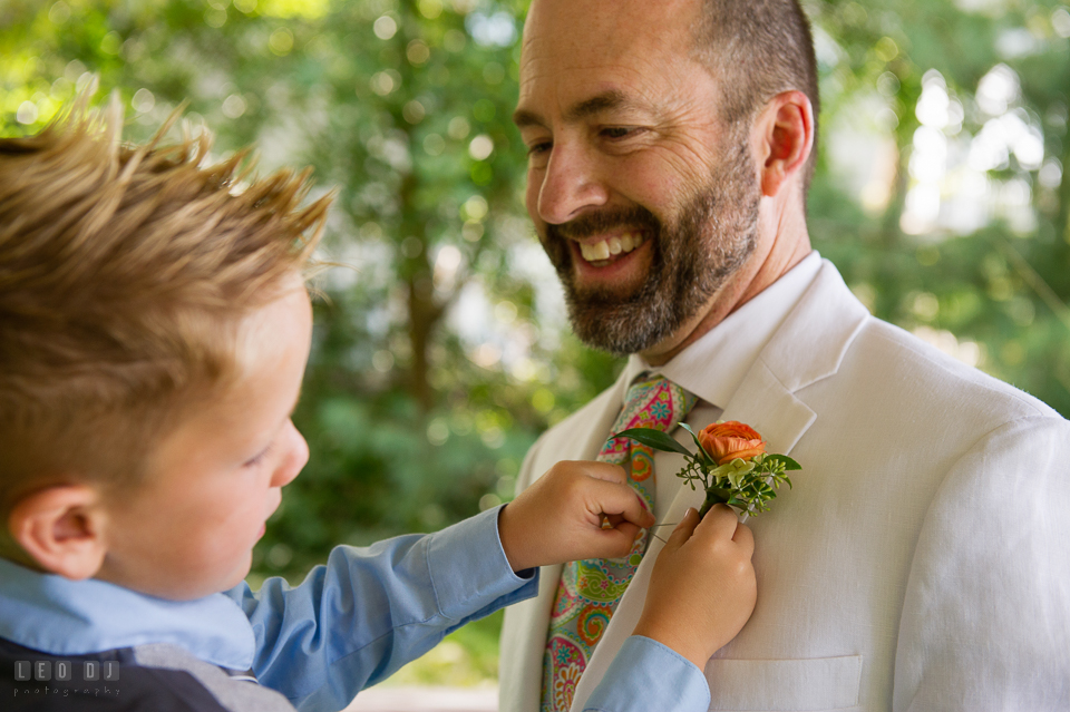 At home backyard wedding nephew put boutonniere on Groom photo by Leo Dj Photography