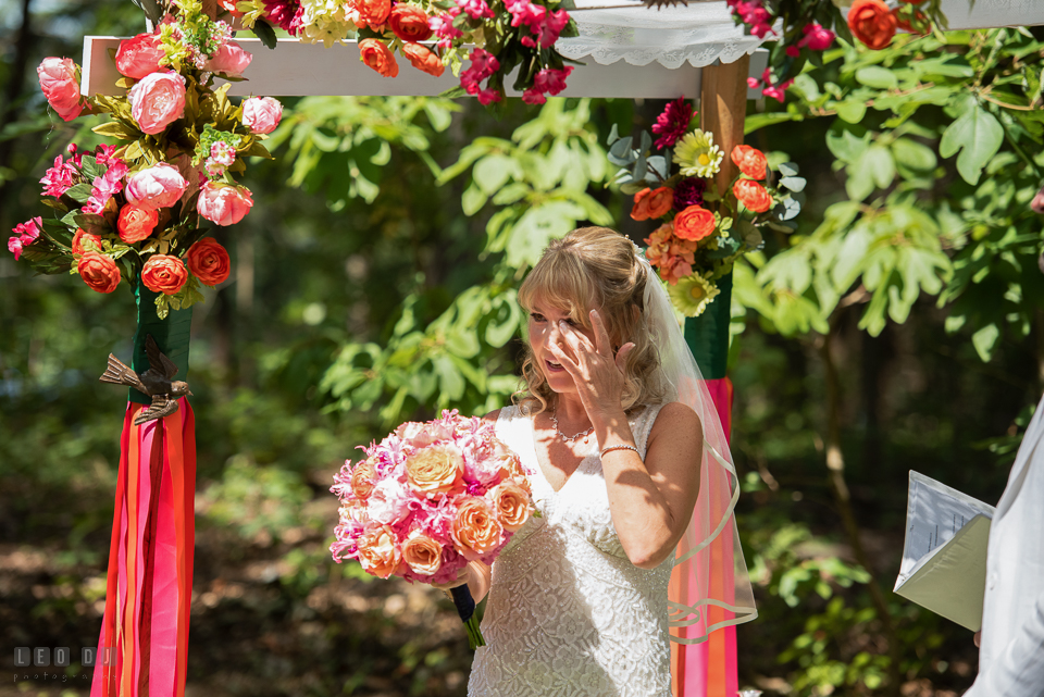 At home backyard wedding Bride wipe of tears hearing speech at ceremony photo by Leo Dj Photography