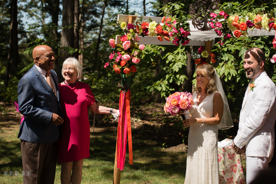 At home backyard wedding Father and Mother of Bride giving speech at ceremony photo by Leo Dj Photography