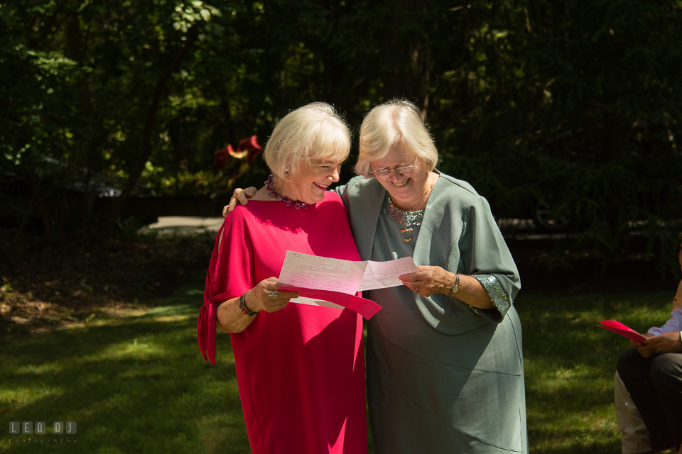 At home backyard wedding Mothers of Bride and Groom reading prayer at ceremony photo by Leo Dj Photography