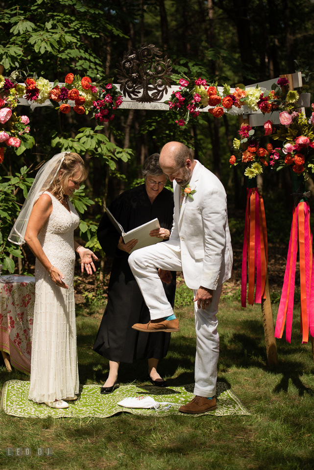 At home backyard wedding Groom stomp glass under chuppah at ceremony photo by Leo Dj Photography