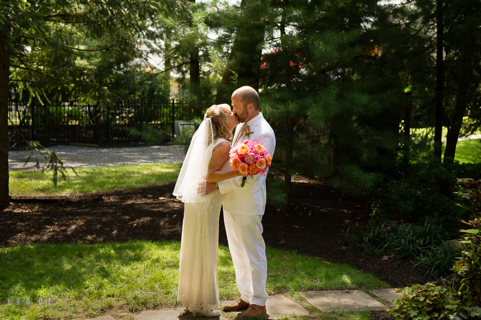 At home backyard wedding Bride and Groom kiss after ceremony photo by Leo Dj Photography