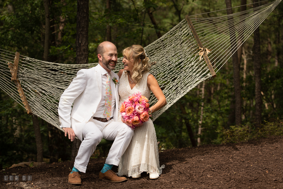 At home backyard wedding Bride and Groom sitting on hammock laughing photo by Leo Dj Photography