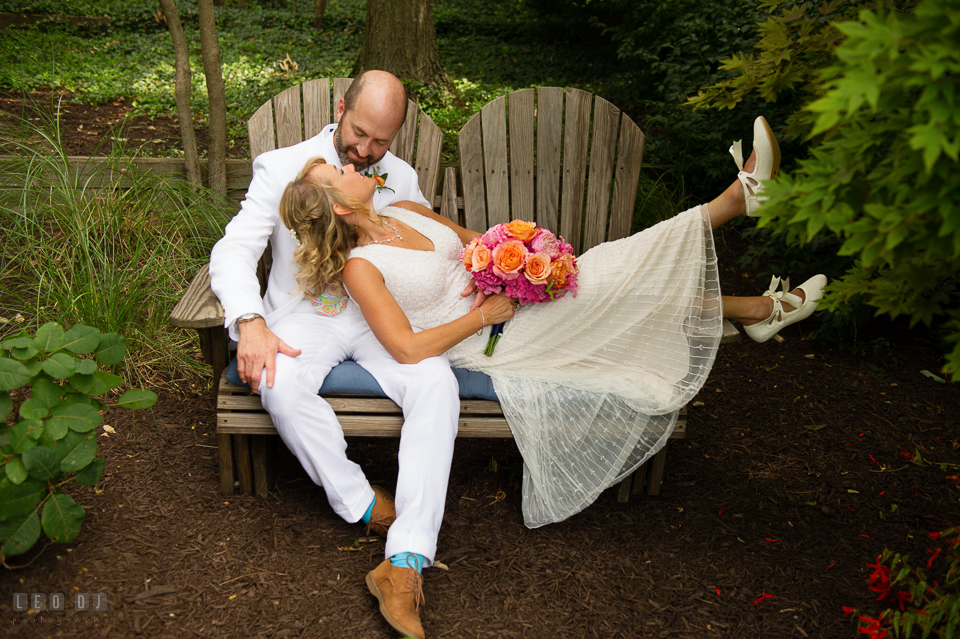 At home backyard wedding Bride lounging on bench with Groom photo by Leo Dj Photography