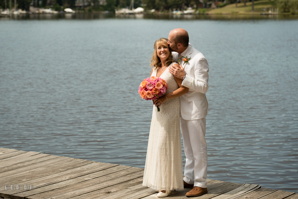 At home backyard wedding Groom kiss Bride on boat pier photo by Leo Dj Photography