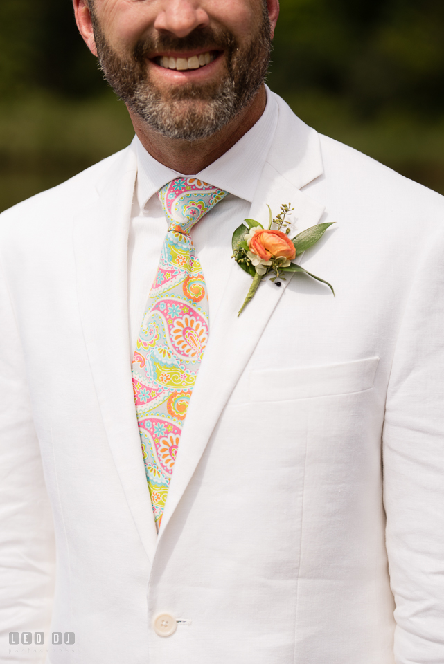 At home backyard wedding close up of Groom's tie and boutonniere photo by Leo Dj Photography