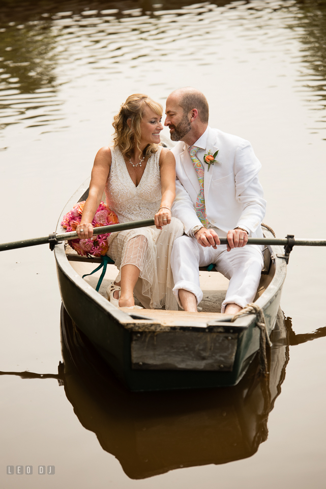 At home backyard wedding Bride and Groom cuddling on boat photo by Leo Dj Photography