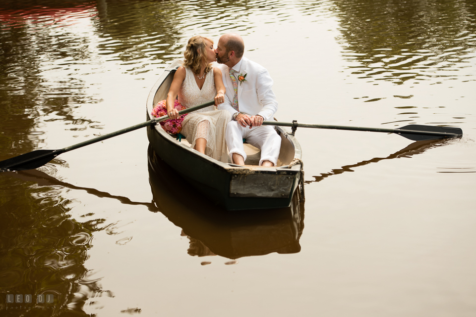 At home backyard wedding Bride and Groom kissing on boat photo by Leo Dj Photography