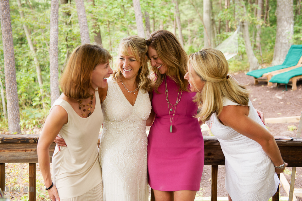 At home backyard wedding Bride laughing with sister and guests photo by Leo Dj Photography