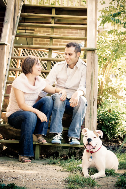 Engaged couple with their boxer dog. Candid Old Town Alexandria Virginia Engagement Photography Session by Wedding Photographer Leo Dj