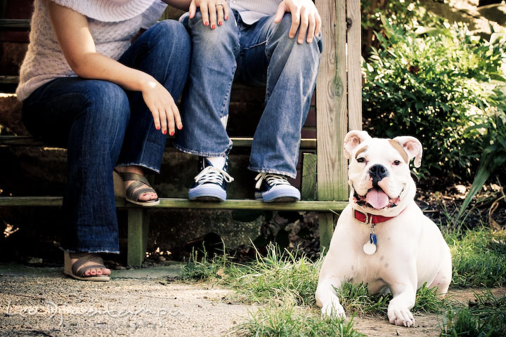 White boxer dog posing with the owner in the background. Candid Old Town Alexandria Virginia Engagement Photography Session by Wedding Photographer Leo Dj