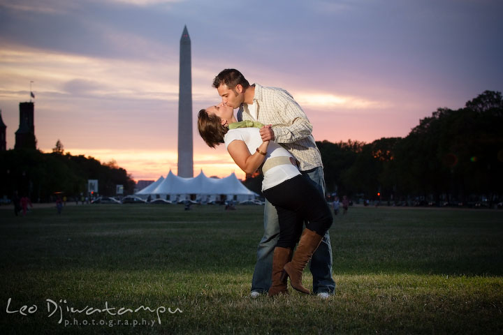Engaged couple kissing, the dip, Washington Monument in the background. Washington DC, Smithsonian, The Mall Pre-wedding Engagement Session Photographer Leo Dj Photography