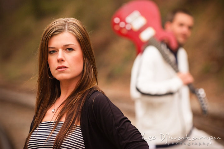 Engaged girl posing while her fiancé is in the background. Pre-Wedding Engagement Photo Session at Sykesville Maryland with Train Rail and Caboose by wedding photographer Leo Dj Photography