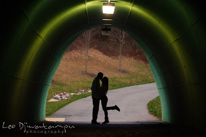Engaged couple kissing in a tunnel. Pre-Wedding Engagement Photo Session at Sykesville Maryland with Train Rail and Caboose by wedding photographer Leo Dj Photography