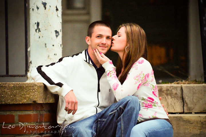 Engaged girl kissed her fiancé on the cheek. Pre-Wedding Engagement Photo Session at Sykesville Maryland with Train Rail and Caboose by wedding photographer Leo Dj Photography