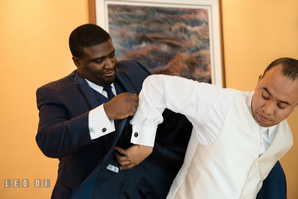 Best Man helps Groom put on tuxedo. Falls Church Virginia 2941 Restaurant wedding ceremony and reception photo, by wedding photographers of Leo Dj Photography. http://leodjphoto.com