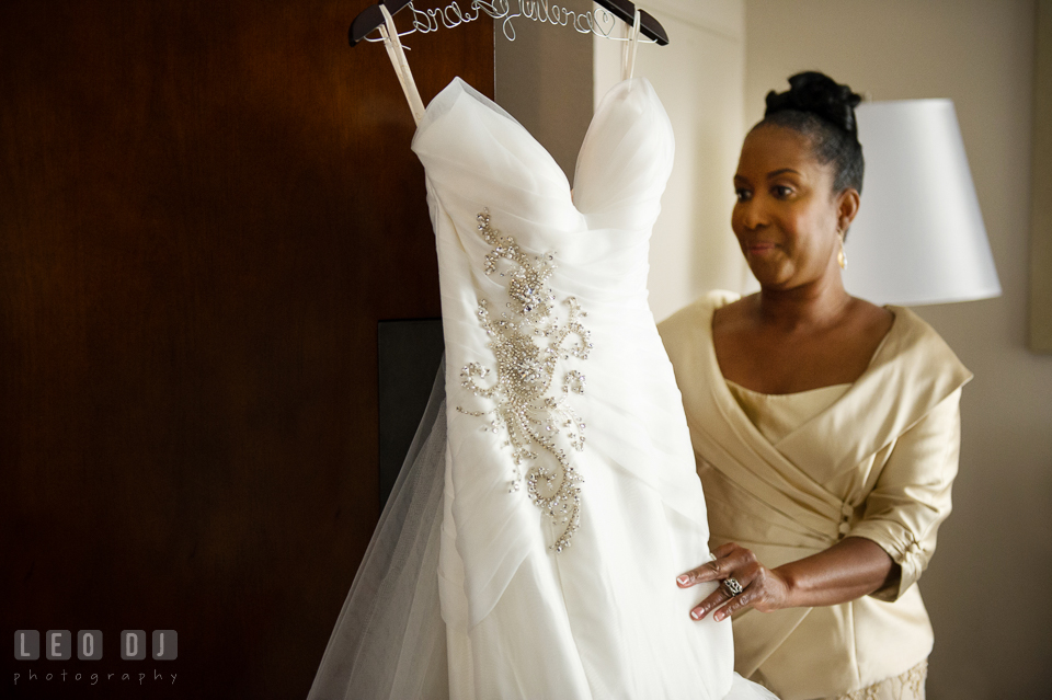 Mother of the Bride looking at the wedding dress by Simone Carvalli from Jeanette's Bridal. Falls Church Virginia 2941 Restaurant wedding ceremony and reception photo, by wedding photographers of Leo Dj Photography. http://leodjphoto.com