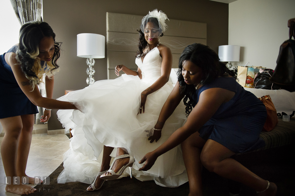 Maid of Honor and Bridesmaid help Bride put on her shoes. Falls Church Virginia 2941 Restaurant wedding ceremony and reception photo, by wedding photographers of Leo Dj Photography. http://leodjphoto.com