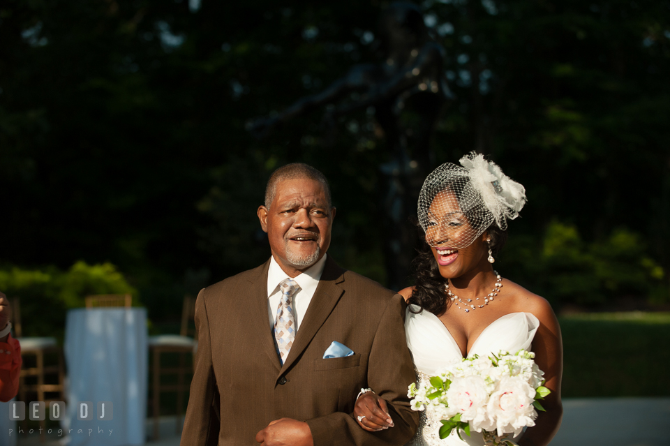 Uncle of the Bride escorted the Bride down the aisle for the wedding ceremony processional. Falls Church Virginia 2941 Restaurant wedding ceremony and reception photo, by wedding photographers of Leo Dj Photography. http://leodjphoto.com