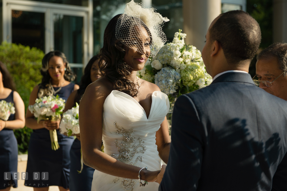 Happy smile from the beautiful Bride during the wedding ceremony. Falls Church Virginia 2941 Restaurant wedding ceremony and reception photo, by wedding photographers of Leo Dj Photography. http://leodjphoto.com