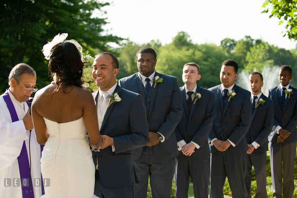 Groom smiling during the ceremony with groom's party in the background. Falls Church Virginia 2941 Restaurant wedding ceremony and reception photo, by wedding photographers of Leo Dj Photography. http://leodjphoto.com