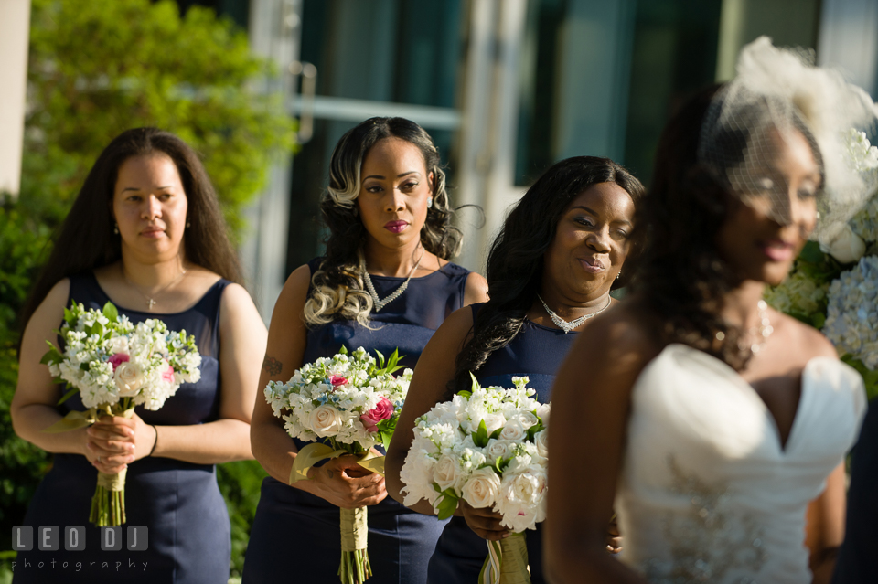 The Maid of Honor and Bridesmaids smiled during the wedding ceremony. Falls Church Virginia 2941 Restaurant wedding ceremony and reception photo, by wedding photographers of Leo Dj Photography. http://leodjphoto.com