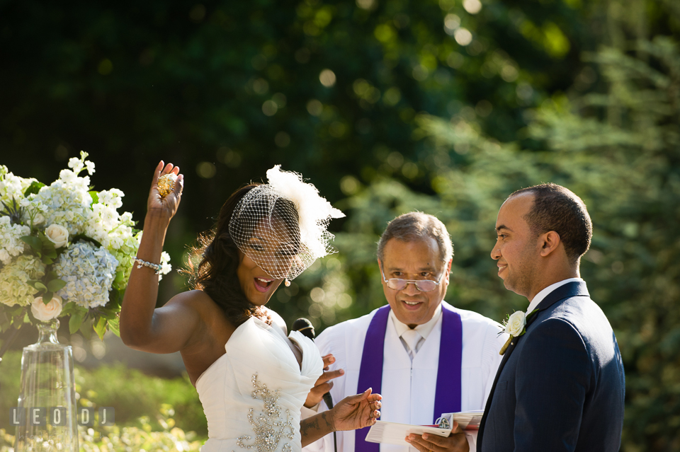 Bride happily showing off her box of gold coins during the wedding ceremony. Falls Church Virginia 2941 Restaurant wedding ceremony and reception photo, by wedding photographers of Leo Dj Photography. http://leodjphoto.com
