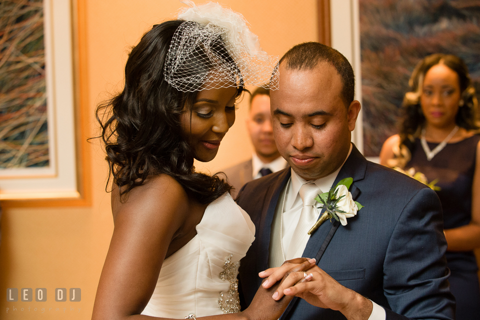 Bride and Groom looking at each other's ring during the first dance. Falls Church Virginia 2941 Restaurant wedding ceremony and reception photo, by wedding photographers of Leo Dj Photography. http://leodjphoto.com