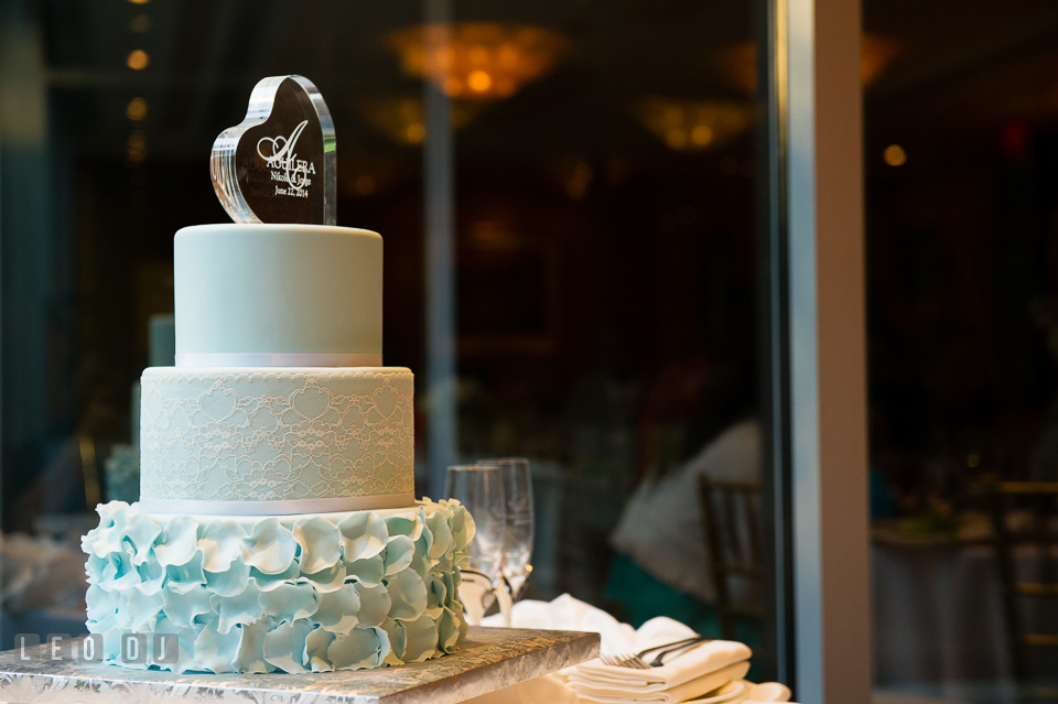 A touch of blue on the wedding cake by Layered Cake Patisserie. Falls Church Virginia 2941 Restaurant wedding ceremony and reception photo, by wedding photographers of Leo Dj Photography. http://leodjphoto.com