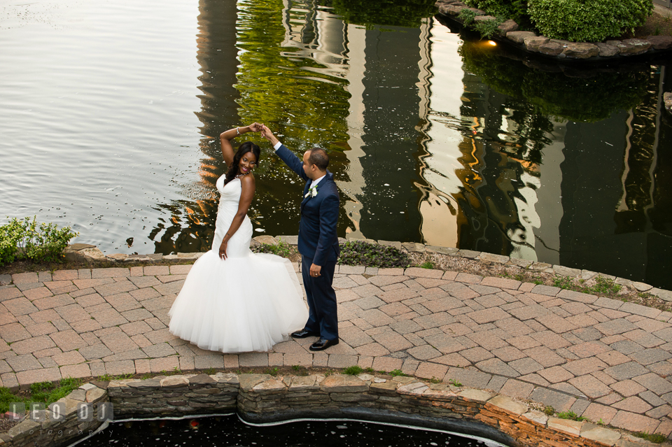 Groom dancing and twirling Bride by the pond. Falls Church Virginia 2941 Restaurant wedding ceremony and reception photo, by wedding photographers of Leo Dj Photography. http://leodjphoto.com