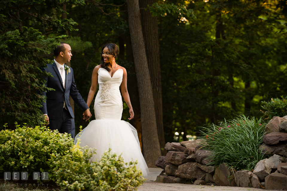The Bride and Groom walking among the gardens. Falls Church Virginia 2941 Restaurant wedding ceremony and reception photo, by wedding photographers of Leo Dj Photography. http://leodjphoto.com