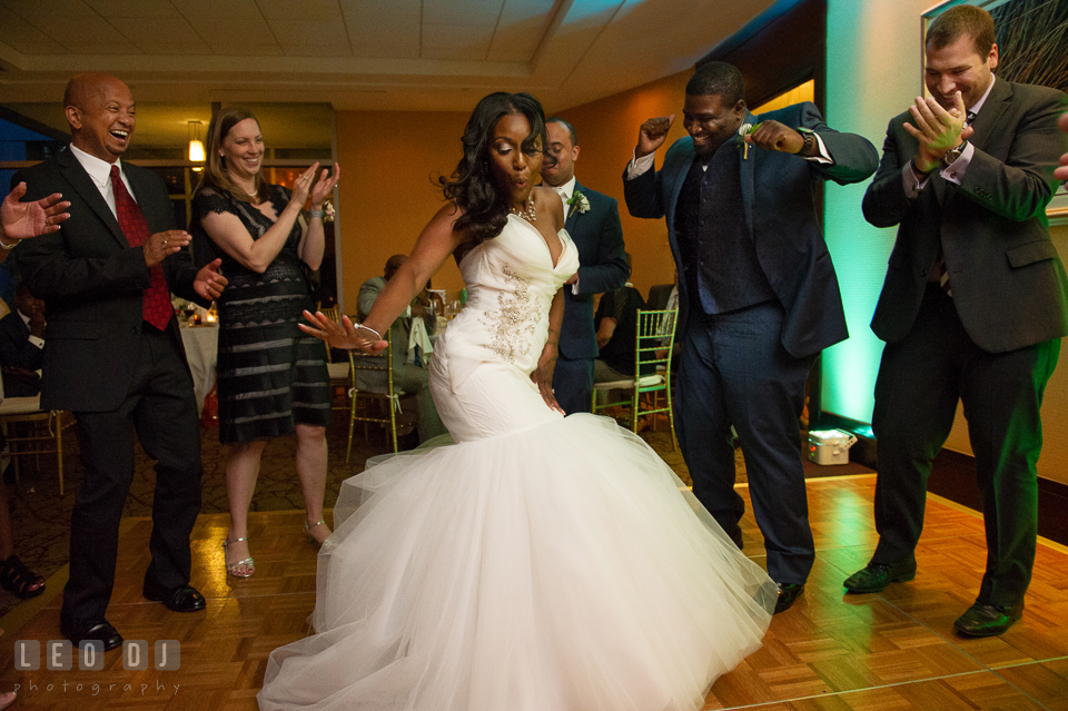 The Bride having fun dancing during the wedding reception cheered by the family. Falls Church Virginia 2941 Restaurant wedding ceremony and reception photo, by wedding photographers of Leo Dj Photography. http://leodjphoto.com