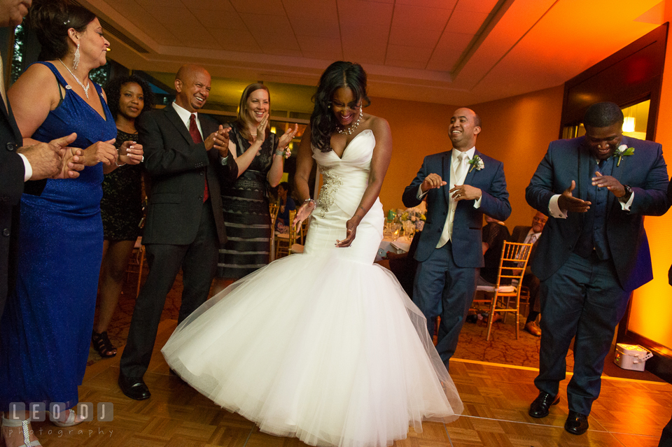 The Bride, Groom, and guests dancing to music from DJ Michael Cruz from Bialek's Music. Falls Church Virginia 2941 Restaurant wedding ceremony and reception photo, by wedding photographers of Leo Dj Photography. http://leodjphoto.com