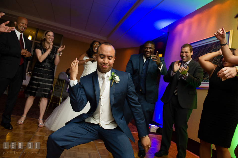 The Groom strike a pose dancing during the open dance floor at the reception. Falls Church Virginia 2941 Restaurant wedding ceremony and reception photo, by wedding photographers of Leo Dj Photography. http://leodjphoto.com