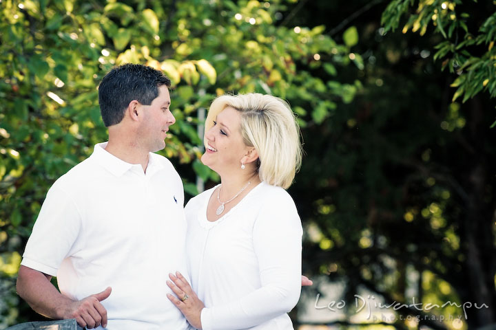 Mother and father talking to each other and smiling. Kent Island, Annapolis, MD Fun Candid Family Lifestyle Photographer, Leo Dj Photography
