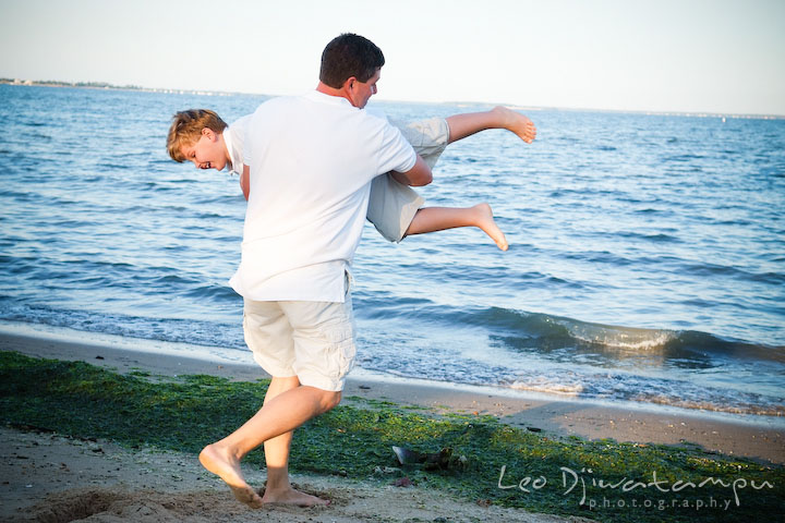 Father swingin his son, pretending going to throw him in the water. Kent Island, Annapolis, MD Fun Candid Family Lifestyle Photographer, Leo Dj Photography