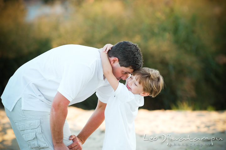 Son embracing dad's neck. Kent Island, Annapolis, MD Fun Candid Family Lifestyle Photographer, Leo Dj Photography