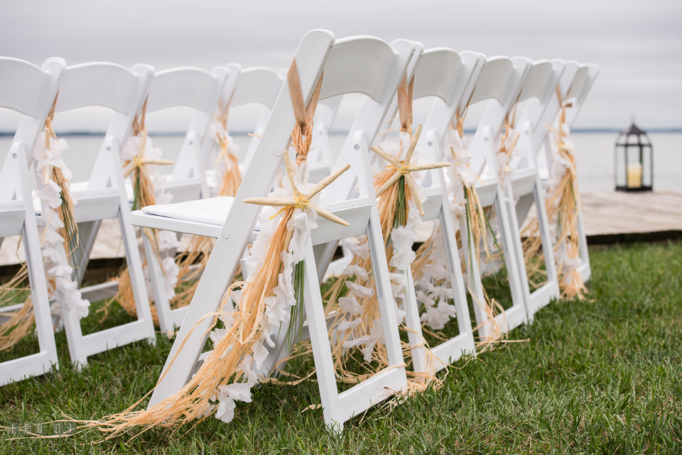 Silver Swan Bayside grass skirt tassels and starfish chair decor photo by Leo Dj Photography