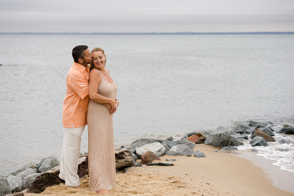 Silver Swan Bayside wedding Groom hug Bride on the beach photo by Leo Dj Photography