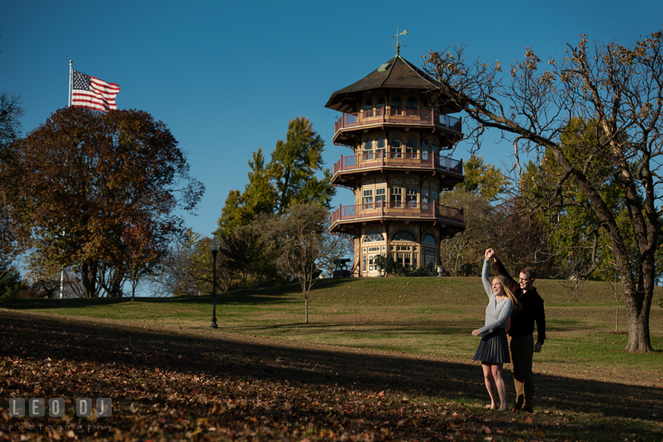 Patterson Park Baltimore Maryland engaged couple dancing by pagoda photo by Leo Dj Photography.