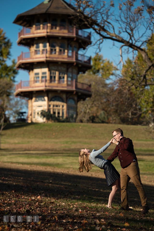 Patterson Park Baltimore Maryland engaged girl dancing with fiance by pagoda photo by Leo Dj Photography.